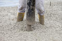 Europe, Germany, Rhineland-Palatinate, Man filling concrete in casing for Stock Photos