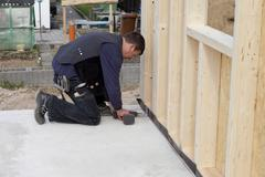 Stock Photo of Europe, Germany, Rhineland Palatinate, Man fixing wooden wall with installing