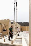 Europe, Germany, Rhineland Palantinate, Men installing and fixing wooden walls Stock Photos