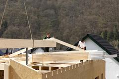 Europe, Germany, Rhineland Palantinate, Men assembling ridge purlin - stock photo