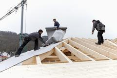 Stock Photo of Europe, Germany, Rhineland Palatinate, Workers roofing on house