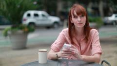 Young Caucasian woman using iPhone smartphone cellphone Stock Footage