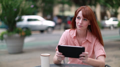 Young Caucasian woman using iPad tablet computer - stock footage