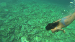 Girl in Goggles Diving From Surface to Seabed - stock footage