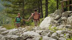 8of12 Young people hiking and trekking on mountain Stock Footage