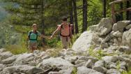 Stock Video Footage of 8of12 Young people hiking and trekking on mountain