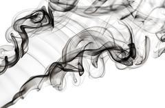 abstract fume pattern: black smoke swirls and curves - stock photo