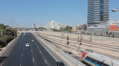 Tel Aviv Highway of Ayalon South and Train over in Railway Stock Footage