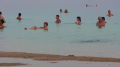 Tourists floating in the Dead Sea, Holy Land, Israel Stock Footage