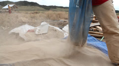 Man Sifts Clay Dirt For Use In Cobb Concrete For Sustainable Earth Home Stock Footage