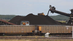 Coal Train Cars Deliver Coal To Conveyor Belt For Bulldozer At Coal Plant Stock Footage