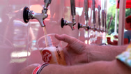 Stock Video Footage of Beer Being Poured and Served From A Truck At A Festival