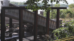 Coal Truck Drops Coal Off into Conveyor Belt for River Barge Stock Footage