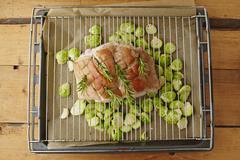 Stock Photo of Suckling pig roasted with brussels sprouts
