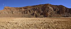 Algeria, Salt pan and crater rim in volcanic landscape of upper Ouksem Crater at - stock photo