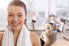 Germany, Brandenburg, Portrait of woman after workout, smiling - stock photo