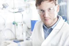 Stock Photo of Germany, Portrait of young chemist