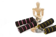 Squeezing hand coil exercise equipment with wooden modle dummy Stock Photos