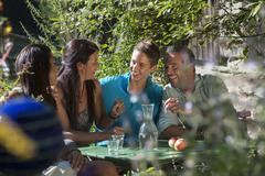 Austria, Salzburg, Family chatting in garden, smiling Stock Photos