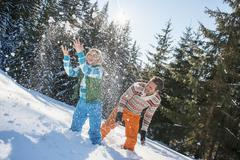 Austria, Salzburg, Couple having fun in snow, smiling - stock photo