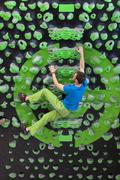 Germany, Bavaria, Munich, Young man bouldering Stock Photos