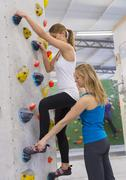 Stock Photo of Germany, Bavaria, Munich, Climber teaching woman to climb