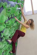 Stock Photo of Germany, Bavaria, Munich, Young woman bouldering