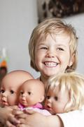 Germany, Girl with her dolls, smiling - stock photo