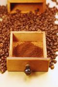 Germany, Wood drawer with ground and whole coffeebeans, close up - stock photo