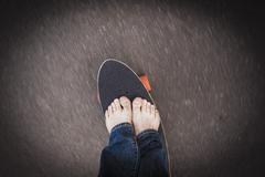 Stock Photo of Germany, North Rhine Westphalia, Duesseldorf, Mature man standing on skateboard