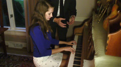 Piano lessons teach teaching Stock Footage