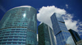 Modern office buildings against sky and clouds, time-lapse. HD Footage