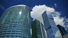 Modern office buildings against sky and clouds, time-lapse. Stock Footage