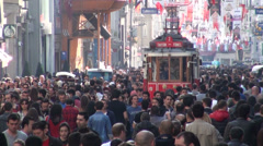 Tram rides through Istanbul shopping street, tourism, travel, crowd, busy Stock Footage