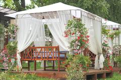 awnings sidewalk cafe in the city garden - stock photo