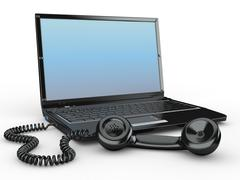 Laptop with old-fashioned phone reciever on white background. 3d Stock Illustration