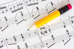 Stock Photo of musical notes with yellow pencil