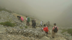 Hikers hiking in the fog. Stock Footage