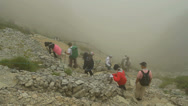 Stock Video Footage of Hikers hiking in the fog.