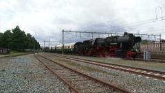 Steam train departure Apeldoorn railway station - on camera Stock Footage