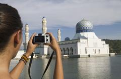 Malaysia, Borneo, Young woman taking photo of City Mosque in Kota Kinabalu Stock Photos