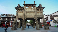 Stock Video Footage of Low angle view of Chinese ancient stone archway against blue sky .