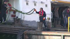 Crew member catches rope of passenger ferry, Istanbul Stock Footage
