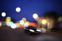 Defocused night street lights background Stock Photos