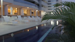 Stock Video Footage of Luxury Hotel Pool at Night