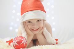Boy holding christmas bauble, smiling, portrait - stock photo