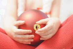 Boy holding christmas bauble, close up - stock photo