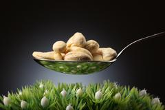 spoon with cashews - stock photo