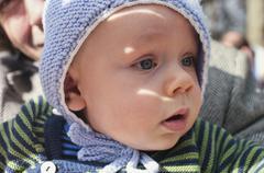 Germany, Hesse, Frankfurt, Baby boy looking away, close up - stock photo