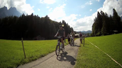 Fisheye Bicycle passing tourists on a path Garmisch-Partenkirchen Bavaria Stock Footage